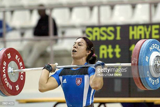 Tunisian Hayet Sassi lifts 1225 kg clean and jerk 15 October 2003 to win gold and also set a new world record in the final of women 63 kg...