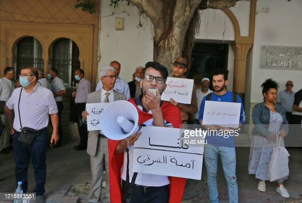 Tunisian human rights activists demonstrate outside a court in the capital Tunis on May 28 in protest against the trial of Emna Charki a 27yearold...