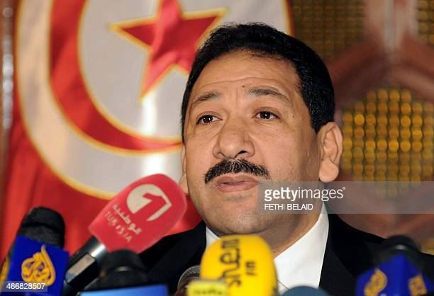 Tunisian Interior Minister Lotfi Ben Jeddou addresses journalists during a press conference in Tunis on February 4 2014 following a gun battle...