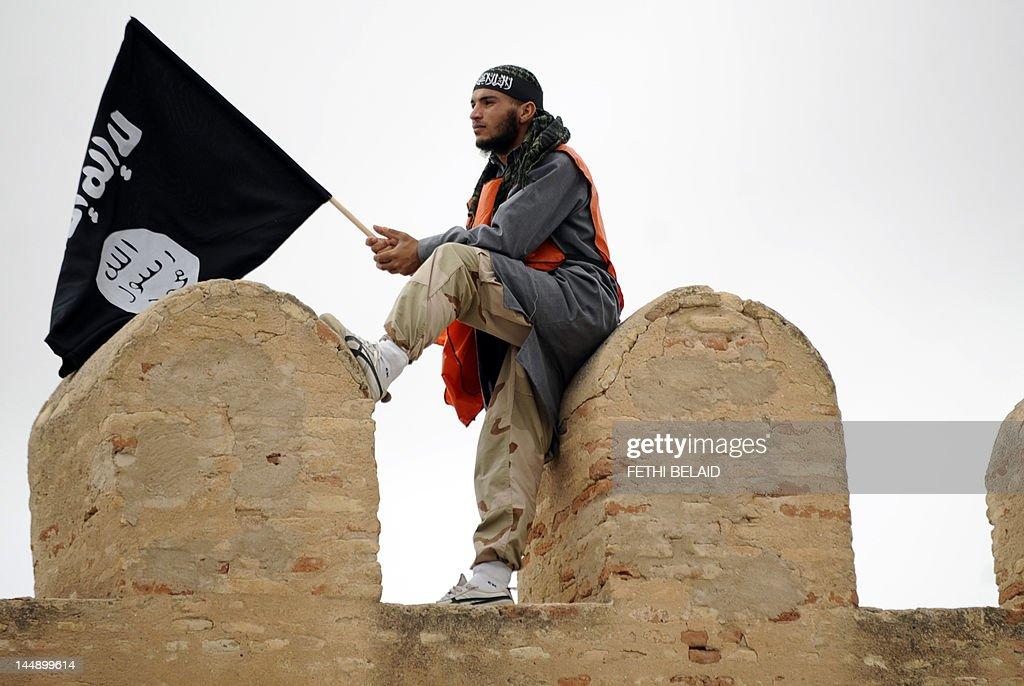 A Tunisian Islamist waves a Salafist fla : News Photo