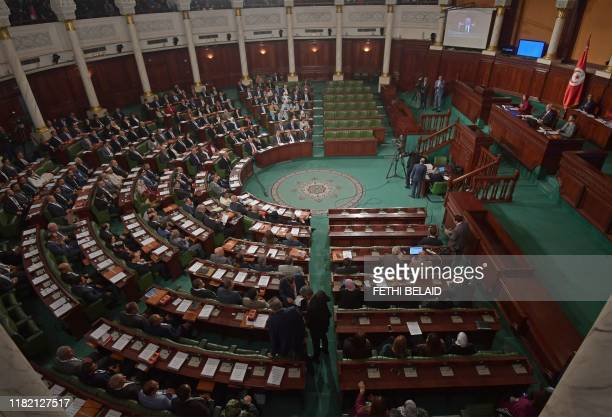 Tunisian Islamist-inspired Ennahdha party leader Rached Ghannouchi chairs the first session of the new parliament following the October elections in...