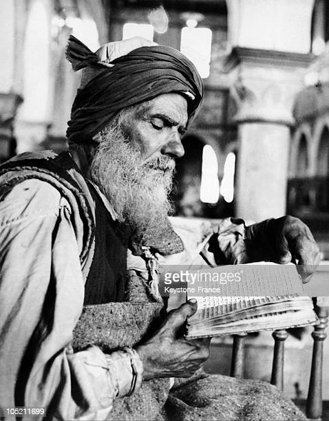 Tunisian Jew Reading A Book Of Prayers In Djerba In 1962