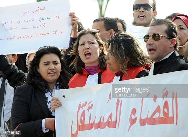 Tunisian judges shout slogans during a demonstration to protest against a law that will be adopted by the Constituent Assembly on January 15 2014 in...