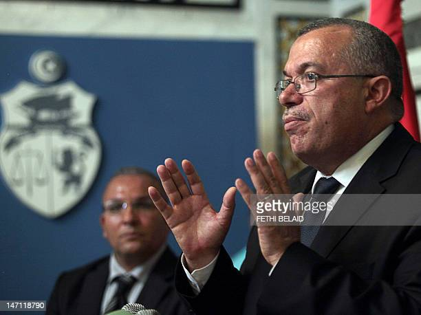 Tunisian Justice Minister Noureddine Bhiri speaks during a press conference in Tunis on June 25 following the extradition of former Libyan Prime...
