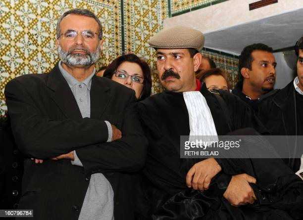 Tunisian lawyers Abderrahman Ayedi and Chokri Belaid look on as they attend a meeting in Tunis on December 29 2010 to express their solidarity with...