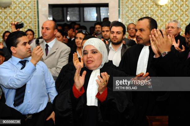 Tunisian lawyers applaud as they attend a meeting in Tunis on December 29 2010 to express their solidarity with the residents of Sidi Bouzid...