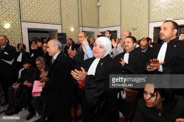 Tunisian lawyers shout slogans during a meeting to show their solidarity with the residents of Sidi Bouzid on December 29 2010 in Tunis following...