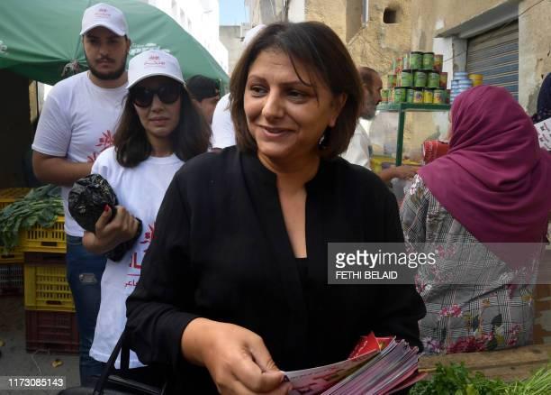 Tunisian legislative candidate Basma Khalfaoui the wife of murdered Tunisian leftist leader Chokri Belaid campaigns on October 2 2019 in Tunis' Cité...