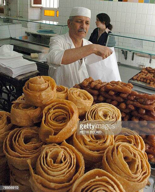 A Tunisian man prepares sweets in a shop in Tunis 22 September 2007 during the Muslim Holy month of Ramadan During the month Muslims have to abstain...