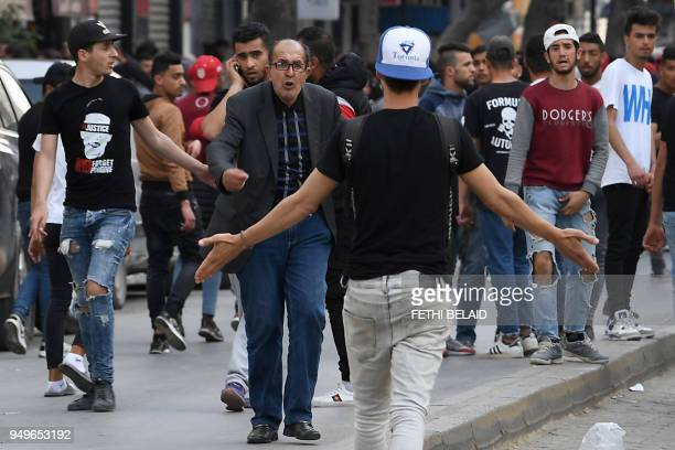 Tunisian men argue as Club Africain fans demonstrate against the police they accuse of causing the death of a supporter in Tunis on April 21 2018 The...