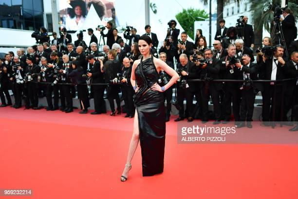Tunisian model Hanaa Ben Abdesslem poses as she arrives on May 16 2018 for the screening of the film 'Burning' at the 71st edition of the Cannes Film...