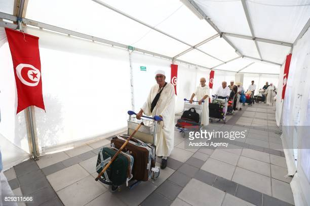 Tunisian Muslims prepare to leave for the annual Hajj pilgrimage to the Holy city of Mecca at the TunisCarthage International Airport in Tunis...