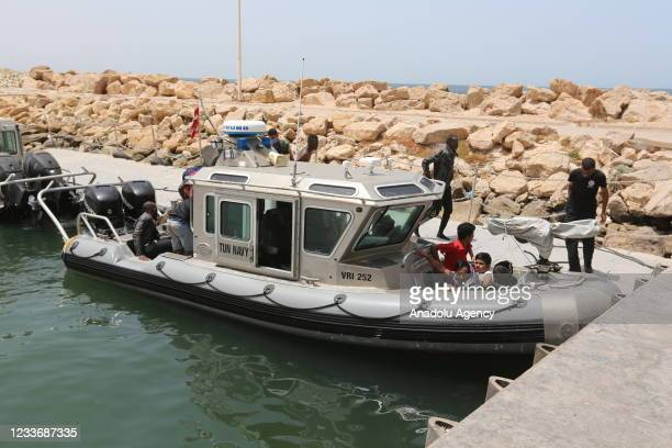 Tunisian naval forces rescue 178 migrants from the Mediterranean after the boats transporting them broke down while trying to reach Europe, in...