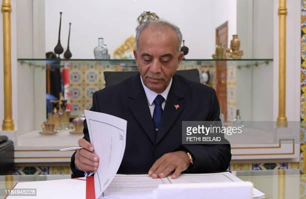 Tunisian new Prime Minister Habib Jemli poses for AFP in his office on November 26 2019 in Tunis Tunisia's president tasked Habib Jemli with forming...