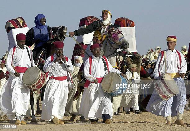 Tunisian nomads parade 27 December 2003 during the opening of the Sahara International Festival in Douz southwestern Tunisia AFP PHOTO FETHI BELAID