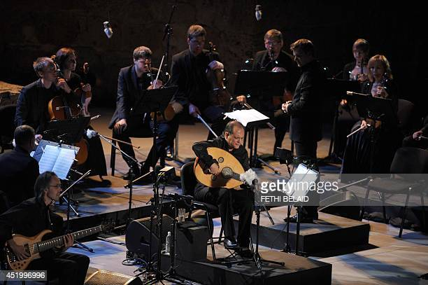 Tunisian oud player and composer Anouar Brahem performs during the opening of the 50th session of the International Carthage Festival on July 10 2014...