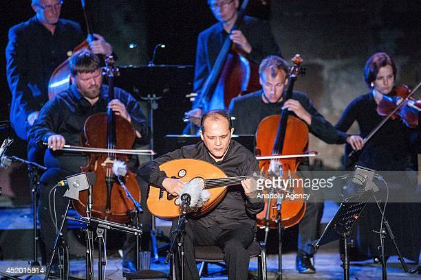 Tunisian oud player and composer Anouar Brahem performs during the 50th International Carthage Festival on July 10 2014 at the Roman theater of...