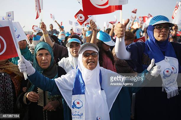Tunisian people gather to support Rashid alGhannushi cofounded of EnNahda Movement during a rally organized for the campaign of elections on 26th...