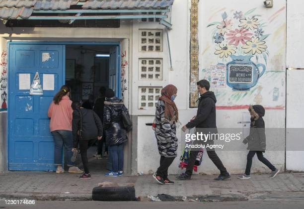 """Tunisian people pursue daily activities in Tunis on the 10th anniversary of the """"Arab Spring"""" in Tunis, Tunisia on December 17, 2020. Ten years ago..."""
