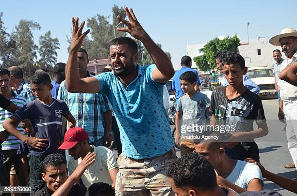 Tunisian people stage a protest over the killing of a young man by Tunisian forces during the clashes near the Libyan border in Ben Gardane town of...