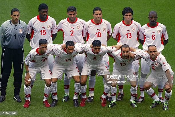 Tunisian players pose for the traditionnal team picture during the Group H first round match Tunisia/Belgium of the 2002 FIFA World Cup in Korea and...