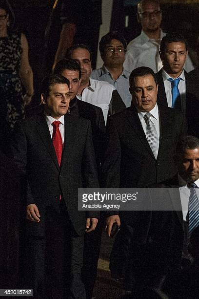 Tunisian PM Mehdi Jomaa arrives as Tunisian oud player and composer Anouar Brahem performs during the 50th International Carthage Festival on July 10...