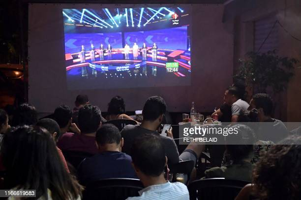 Tunisian poeple watch the Presidential TV debate in a cafe on September 7 in Tunis Days before the first round of Tunisia's presidential election the...