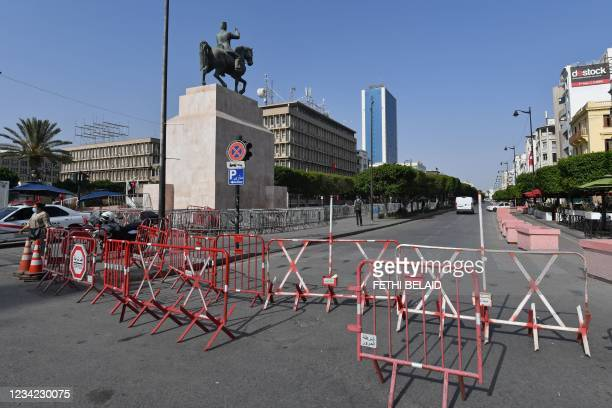 Tunisian police barricade the Habib Bourguiba avenue in Tunis on July 27, 2021. - Tunisia, the birthplace of the Arab Spring revolts a decade ago and...