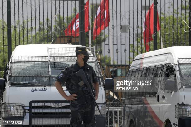 Tunisian police stand guard outside the parliament in Tunis on July 27, 2021. - Tunisia, the birthplace of the Arab Spring revolts a decade ago and...