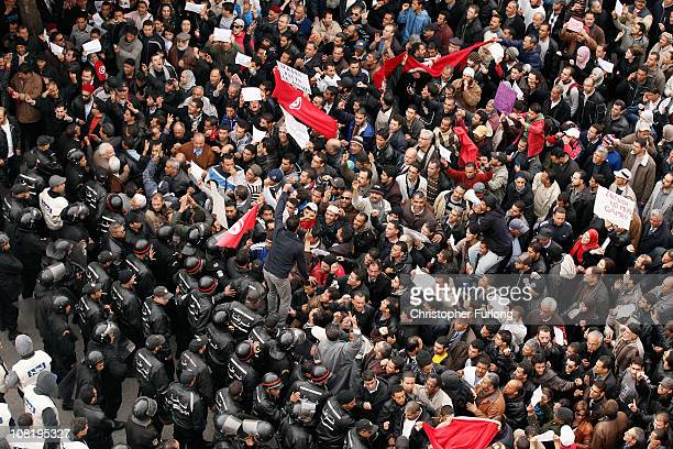 Tunisian police stop protestors along Avenue Bourghiba on January 20 2011 in Tunis Tunisia Police fired warning shots into the air as demonstrators...