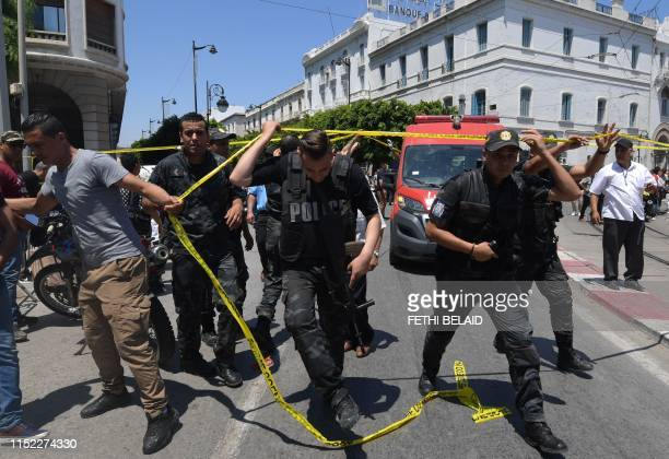 Tunisian police work at the site of an attack in the Tunisian capital's main avenue Habib Bourguiba on June 27 2019 A suicide attack targeted police...