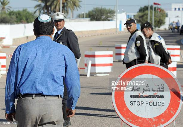 Tunisian policemen stand guard outside the Ghriba synagogue in Djerba on May 10 2009 Tunisia's Jewish community celebrates the annual pilgrimage to...