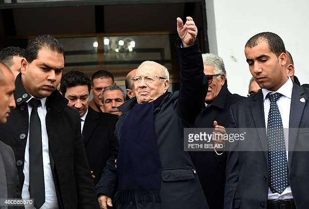 Tunisian presidencial candidate and former prime minister Beji Caid Essebsi waves to supporters during his presidencial elections campaign tour on...