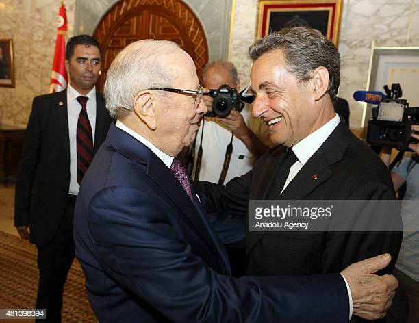 Tunisian President Beji Caid Essebsi greets former French president Nicolas Sarkozy on July 20, 2015 at the Carthage presidential Palace on the...