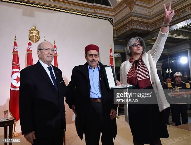 Tunisian President Beji Caid Essebsi honours Besma Khalfaoui the widow of slain Tunisian opposition leader Chokri Belaid and his father Salah Belaid...