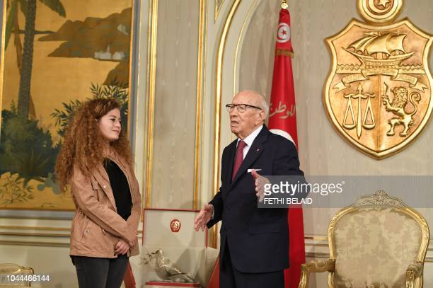 Tunisian President Beji Caid Essebsi receives Palestinian activist Ahed Tamimi on October 2 2018 in Tunis Tamimi a teenager who became a symbol of...