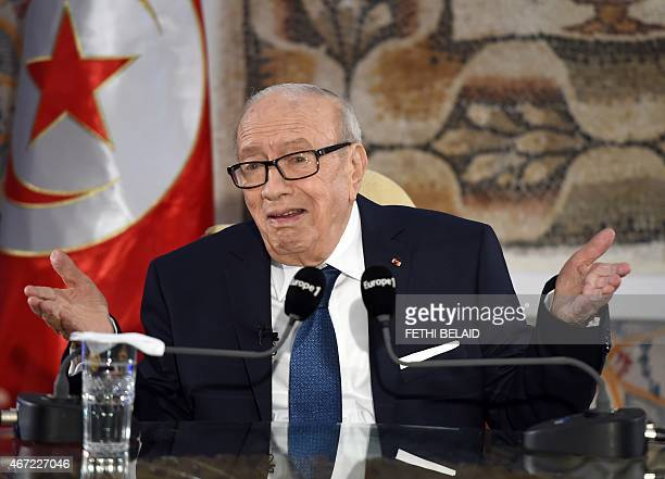 Tunisian President Beji Caid Essebsi speaks during a press conference on March 22 2015 following his visit at the National Bardo Museum in Tunis to...