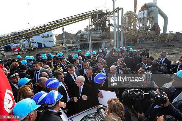 Tunisian President Beji Caid Essebsi visits a new unit at a phosphate production plant in the town of Metlaoui in the Gafsa Governorate on the sixth...