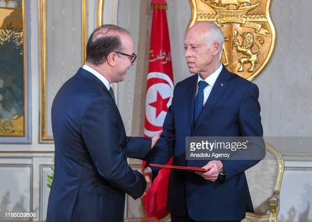 Tunisian President Kais Saied gives letter of tasking to Tunisian former Finance Minister Elyes Fakhfakh to form new government at the Carthage...