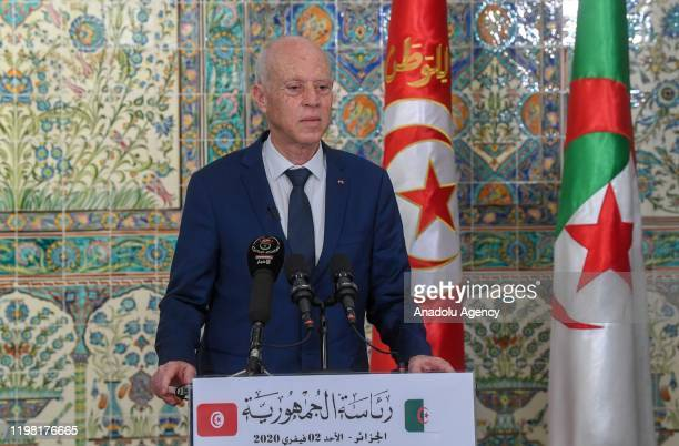 Tunisian President Kais Saied makes a speech during the joint press conference with Algerian President Abdelmadjid Tebboune following their meeting...