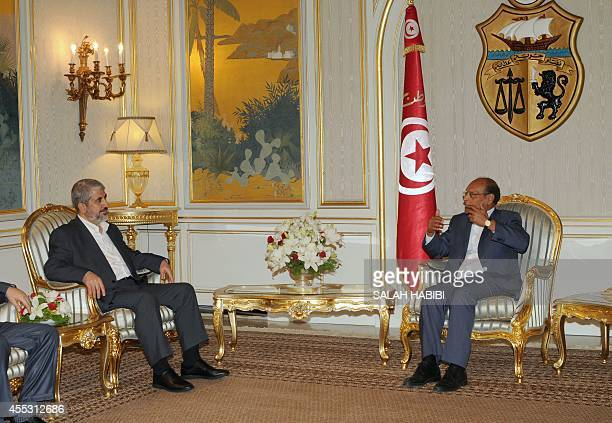 Tunisian president Moncef Marzouki speaks during a meeting with Hamas leader Khaled Meshaal at the Carthage presidential palace on the outskirts of...