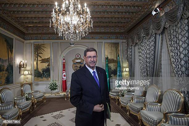 Tunisian Prime Minister Habib Essid arrives to unveil his cabinet lineup which includes one member of the Islamist Ennahda movement at the...