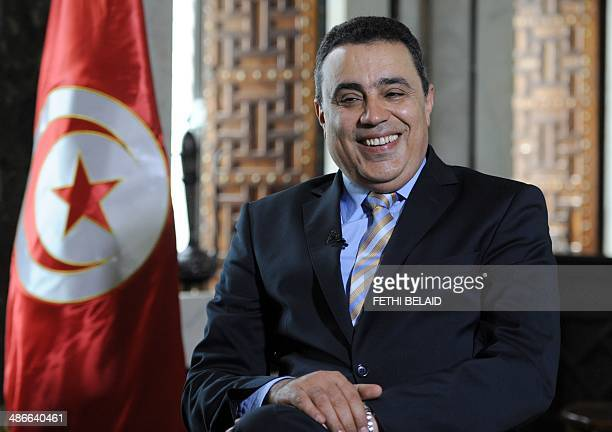 Tunisian Prime Minister Mehdi Jomaa smiles during an exclusive interview with AFP journalists at his residence in Tunis on April 25 2014 Jomaa said...