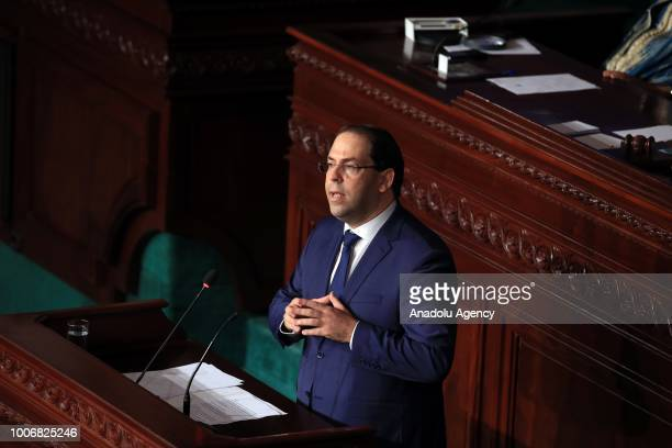 Tunisian Prime Minister Youssef Chahed addresses lawmakers durinh the parliament session on vote of confidence for Hisham alFurati appointed as...