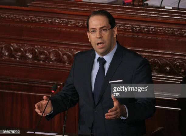 Tunisian Prime Minister Youssef Chahed addresses parliament during a session in Tunis on March 23 amidst calls to reshuffle government / AFP PHOTO /...