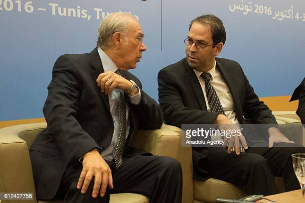 Tunisian Prime Minister Youssef Chahed and SecretaryGeneral of the Organisation for Economic Cooperation and Development Angel Gurria attend the...