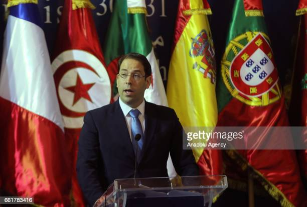 Tunisian Prime Minister Youssef Chahed delivers a speech during the Third Ministerial Conference of the Dialogue 55 titled 'Promotion of Research...