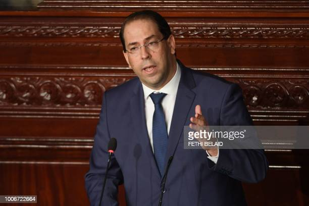 Tunisian prime minister Youssef Chahed gives a speech prior to a confidence bill during a plenary session at the Tunisian parliament in the capital...