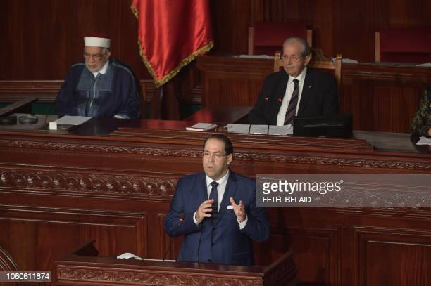 Tunisian Prime Minister Youssef Chahed speaks during a plenary session at the Tunisian parliament in the capital Tunis on November 12 2018