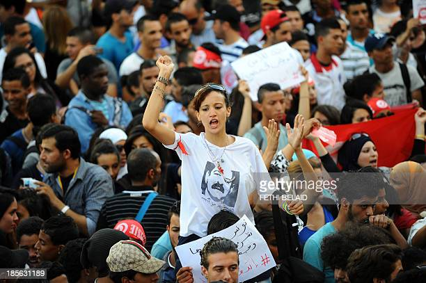 A Tunisian protester wearing a shirt depicting late opposition figure Chokri Belaid shouts slogans during a demonstration in Tunis' central Habib...